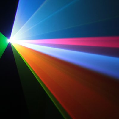 Multicolored beams of light originate from a single light source.