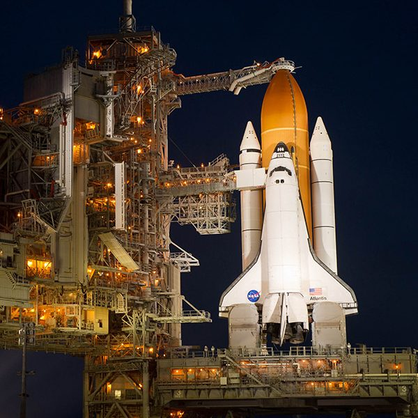 A space shuttle prepares for a night time launch.