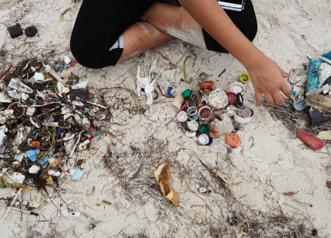 Someone collecting beach pollution
