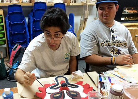 Two young men work on an activity as part of the Nature Links program.