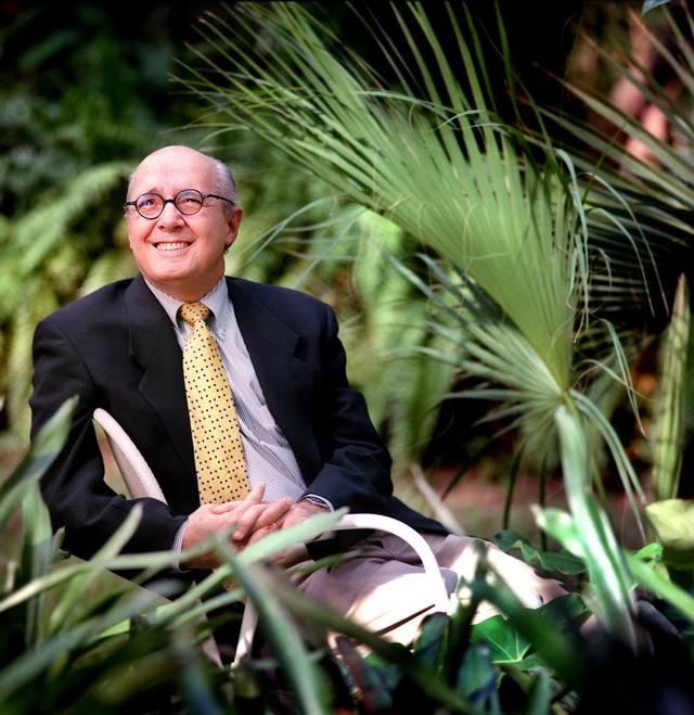 Man taking a photo among vegetation