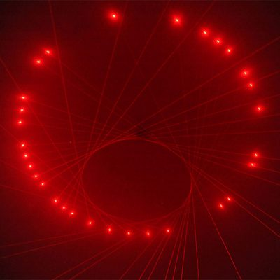 An installation of red lasers projected in a circular formation