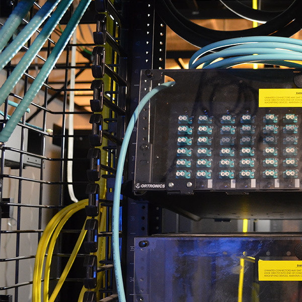 Colorful wires wrap around the structure housing the museum's circuit room.