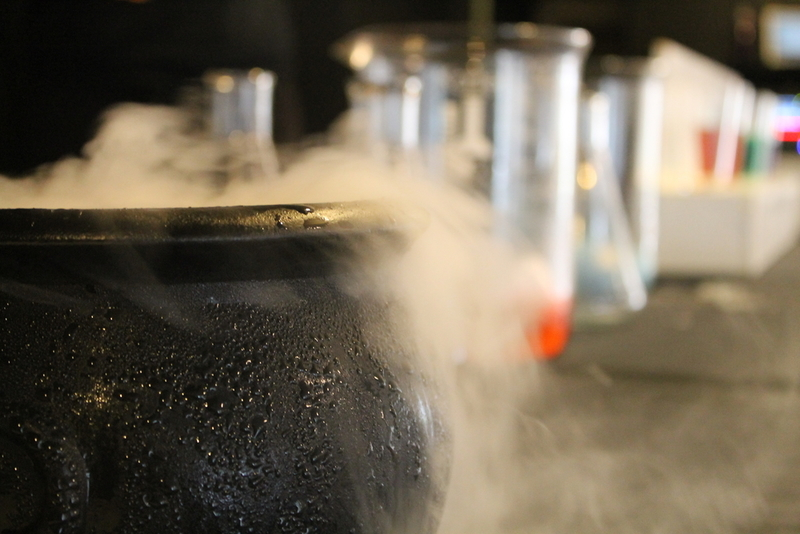 DRY ICE: To help differentiate a physical reaction from a chemical reaction, the Frost Science team creates a fun physical reaction by dropping dry ice into water, resulting in a spooky bubbling cauldron. The water molecules stay the same, but the physical form changes in a rather bewitching way.