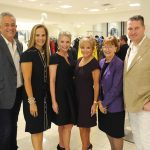 Group of adults posing for a photo at the Badgley Mischka Event