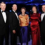Adults posing for a photo at a gala