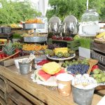 Collection of different foods and fruits for an event