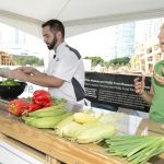 Demonstrator and chef presenting ingredients
