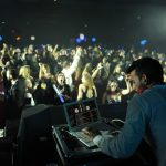 DJ performing for a large crowd