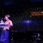 Woman presenting at a science event