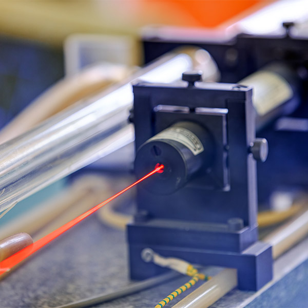 A bright red laser is produced by a machine.