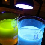 Solids aren't the only state of matter that demonstrate fluorescent qualities with ultraviolet light—certain liquids do too! The beaker on the left contains tap water and fluorescein; the beaker on the right holds tonic water with quinine (an antimalarial).