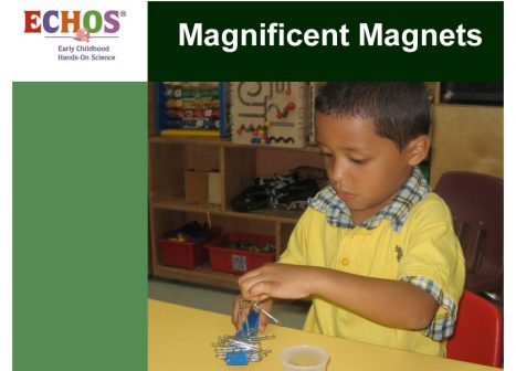 Young boy using magnets and paper clips