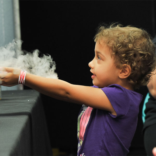 Young girl with smoke in her hands