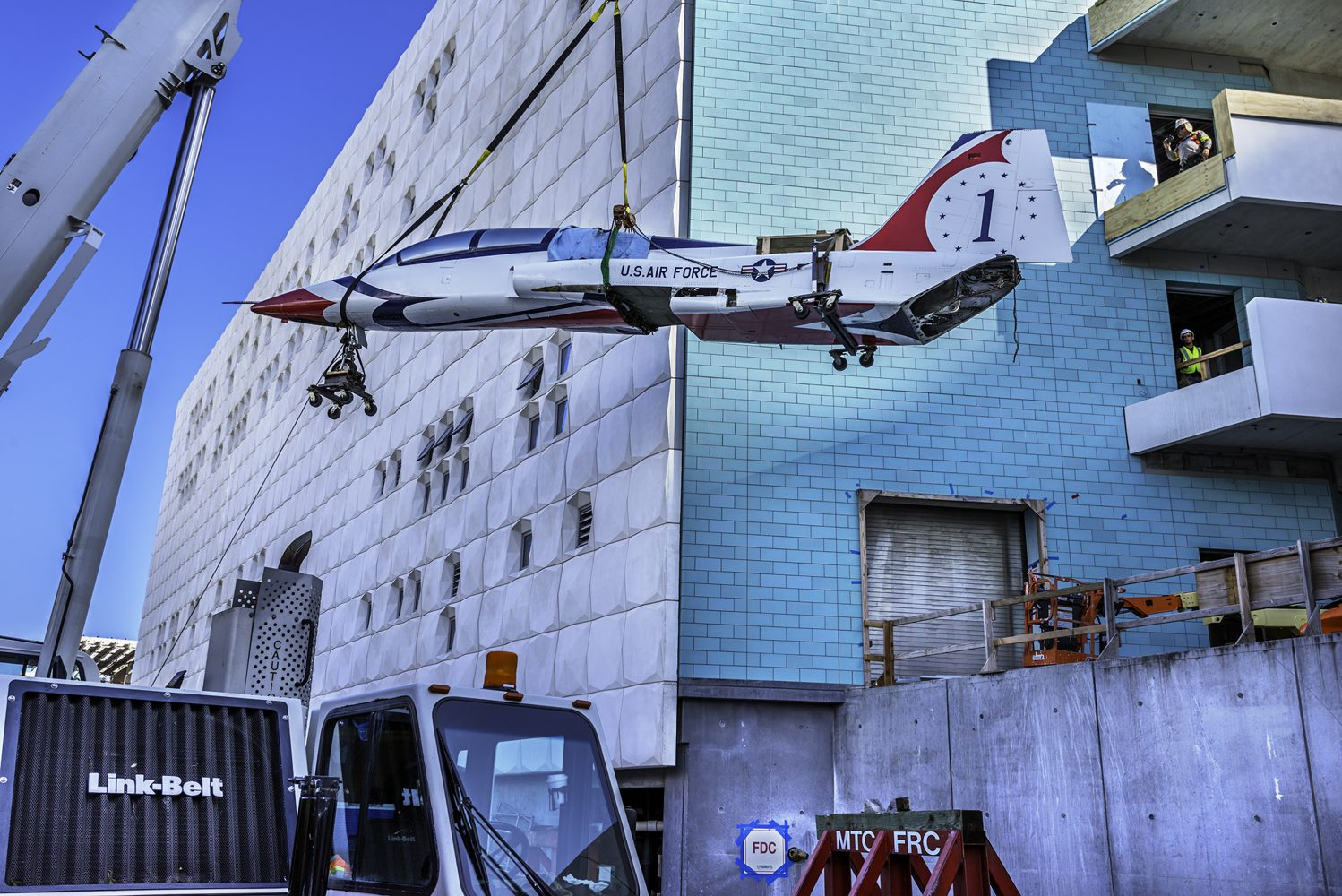 Large plane being lifted into a museum