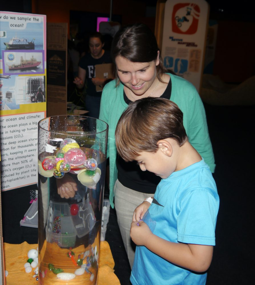 Young boy being led by an adult during an experiment