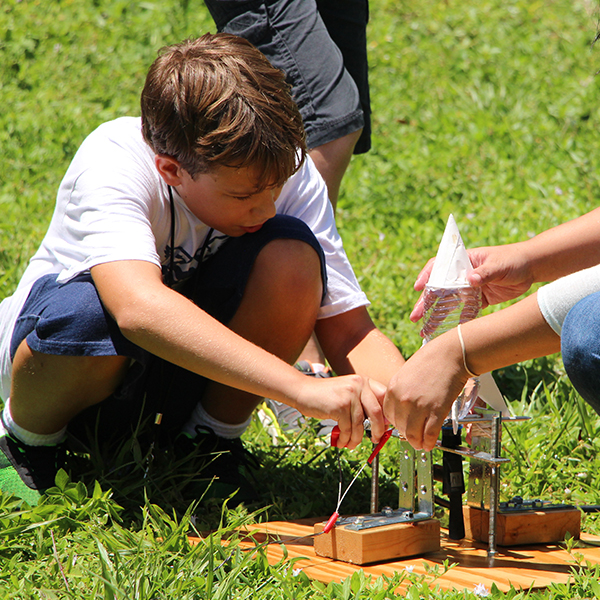 Young boy setting up a rocket