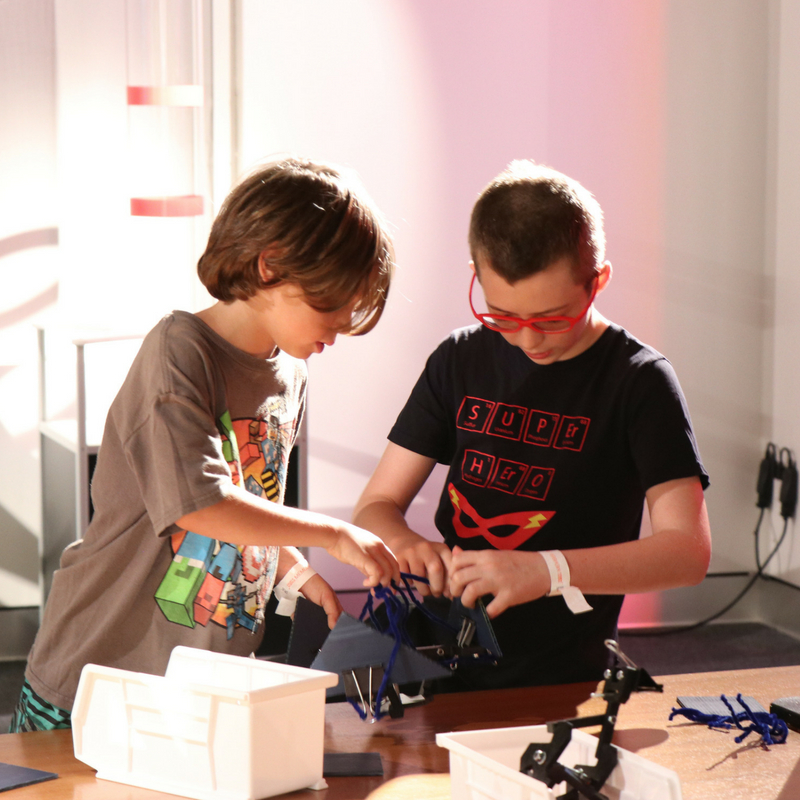 kids building a claw as part of the Design Lab: Engineering activities