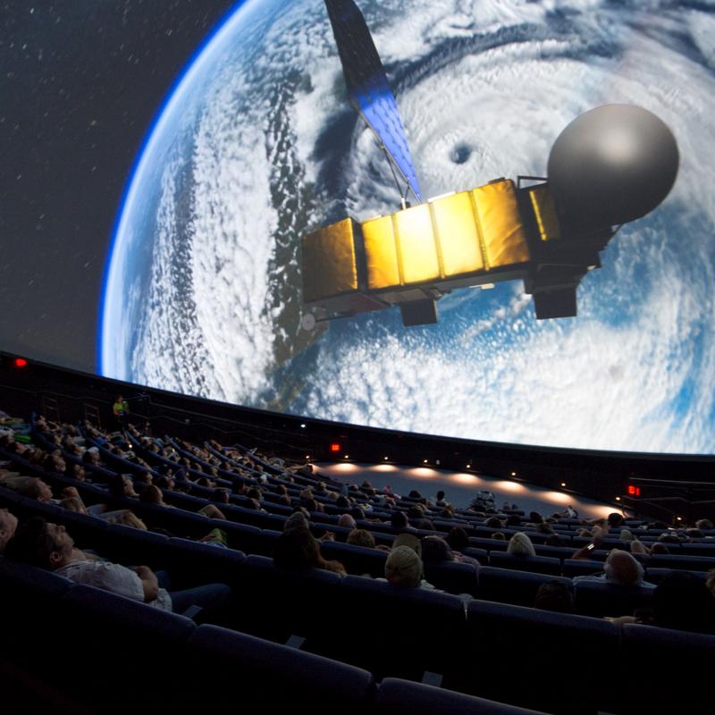 watching a planetarium show