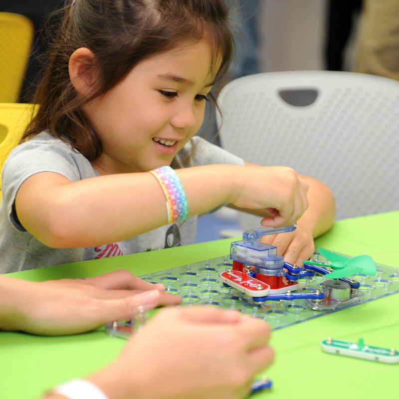 child building a fan using snap circuits