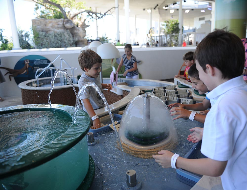 Children playing with Water Tables