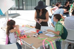 family-creating-kites-at-frost-science
