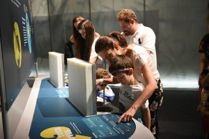 family-learning-about-brain-exhibit