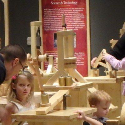 Visitors explore Building Science exhibit.