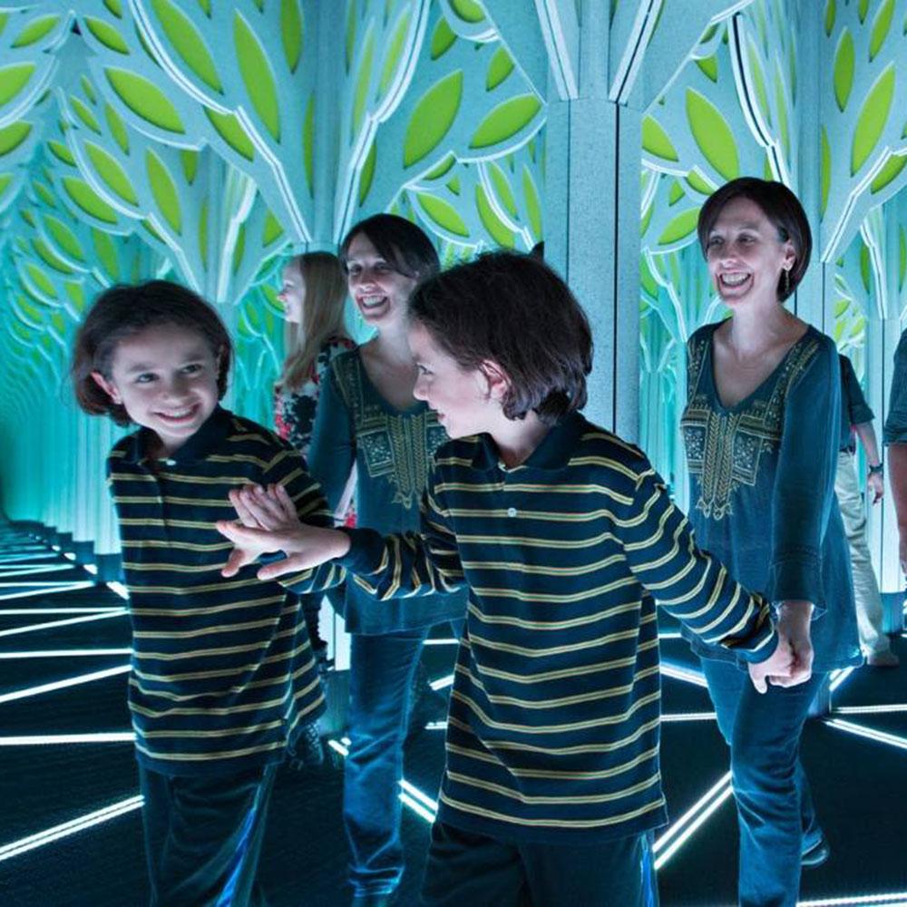 Children exploring mirror maze.