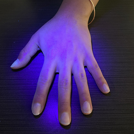 Glo Germ is not visible on hand after 20 seconds of washing.