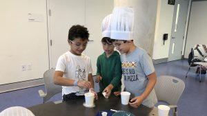 Children cooking in summer class.