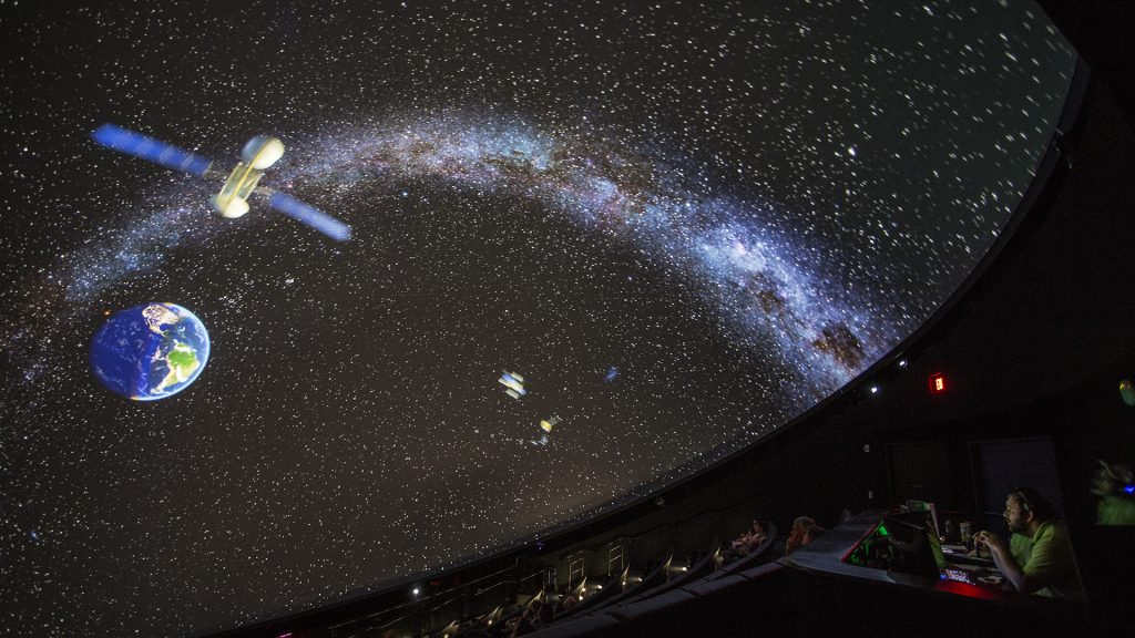 Image of earth and spacecraft on displayed on Planetarium dome,
