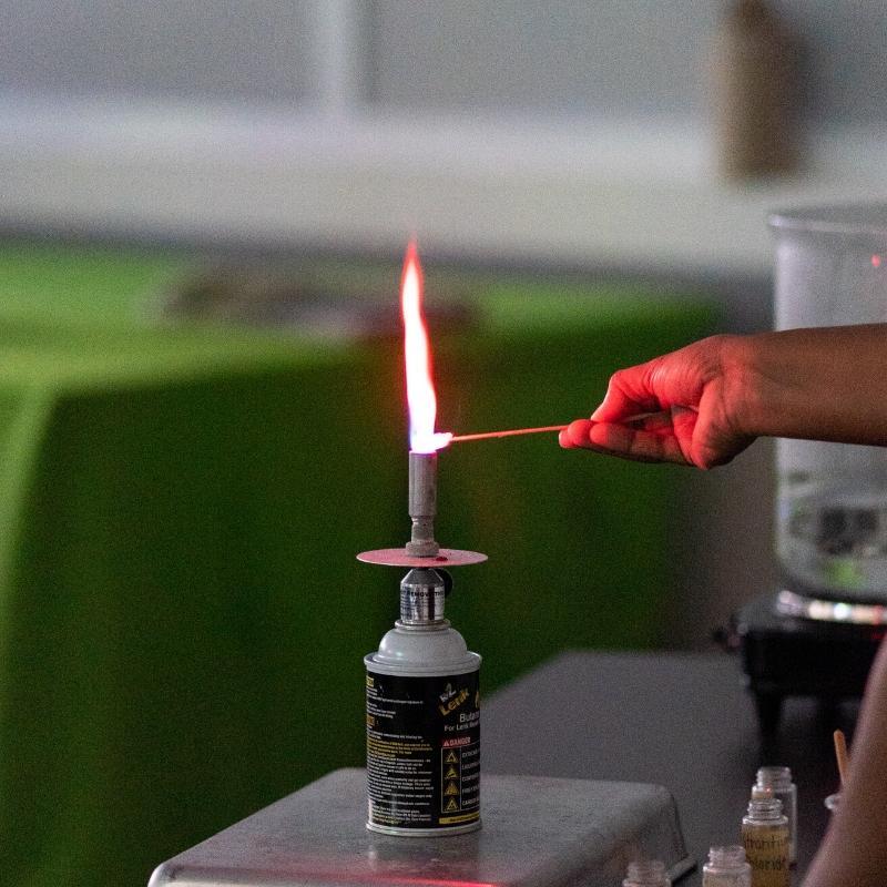 image of bunsen burner with orange flame