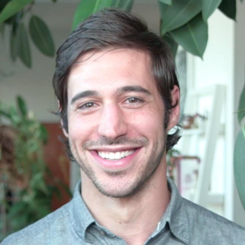 man smiling wearing green shirt